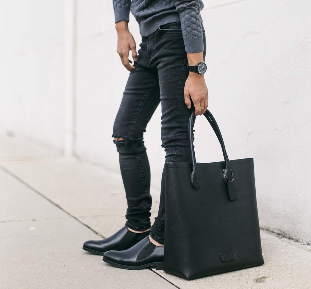 H&M   black distressed denim ,  Coach x Gary Baseman  tote bag , Triwa   black watch