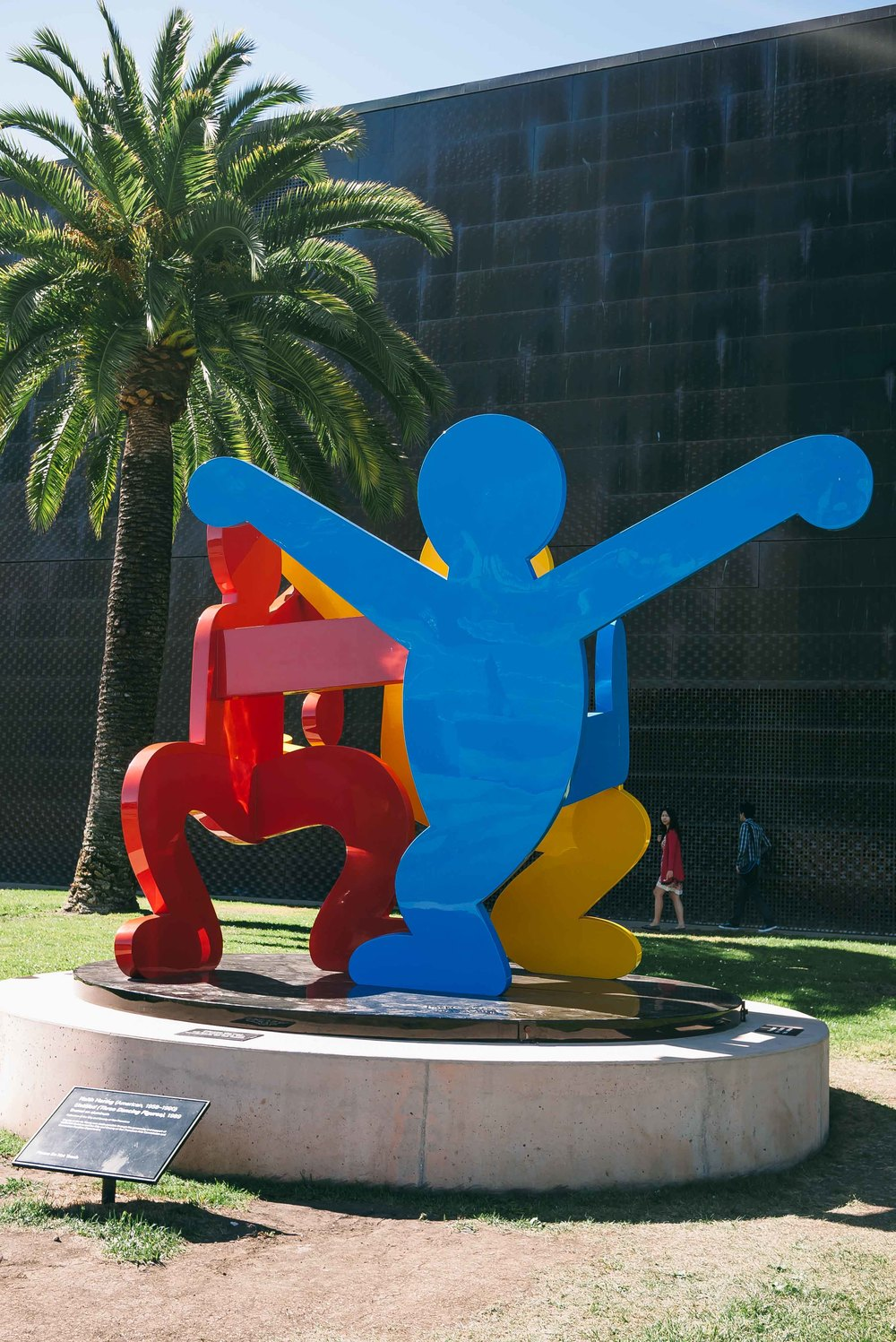 A   Keith Haring   sculpture welcomes museum members and prospective visitors.