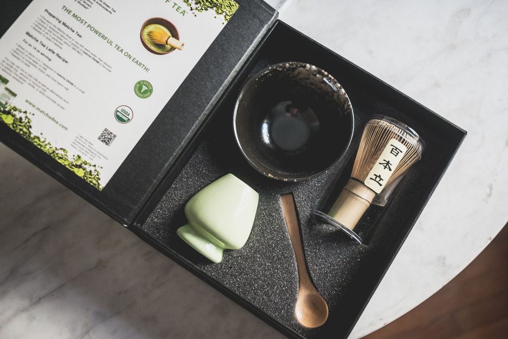A ceremony matcha tea set includes handmade tea bowl, ceramic whisk holder, bamboo whisk and spoon.