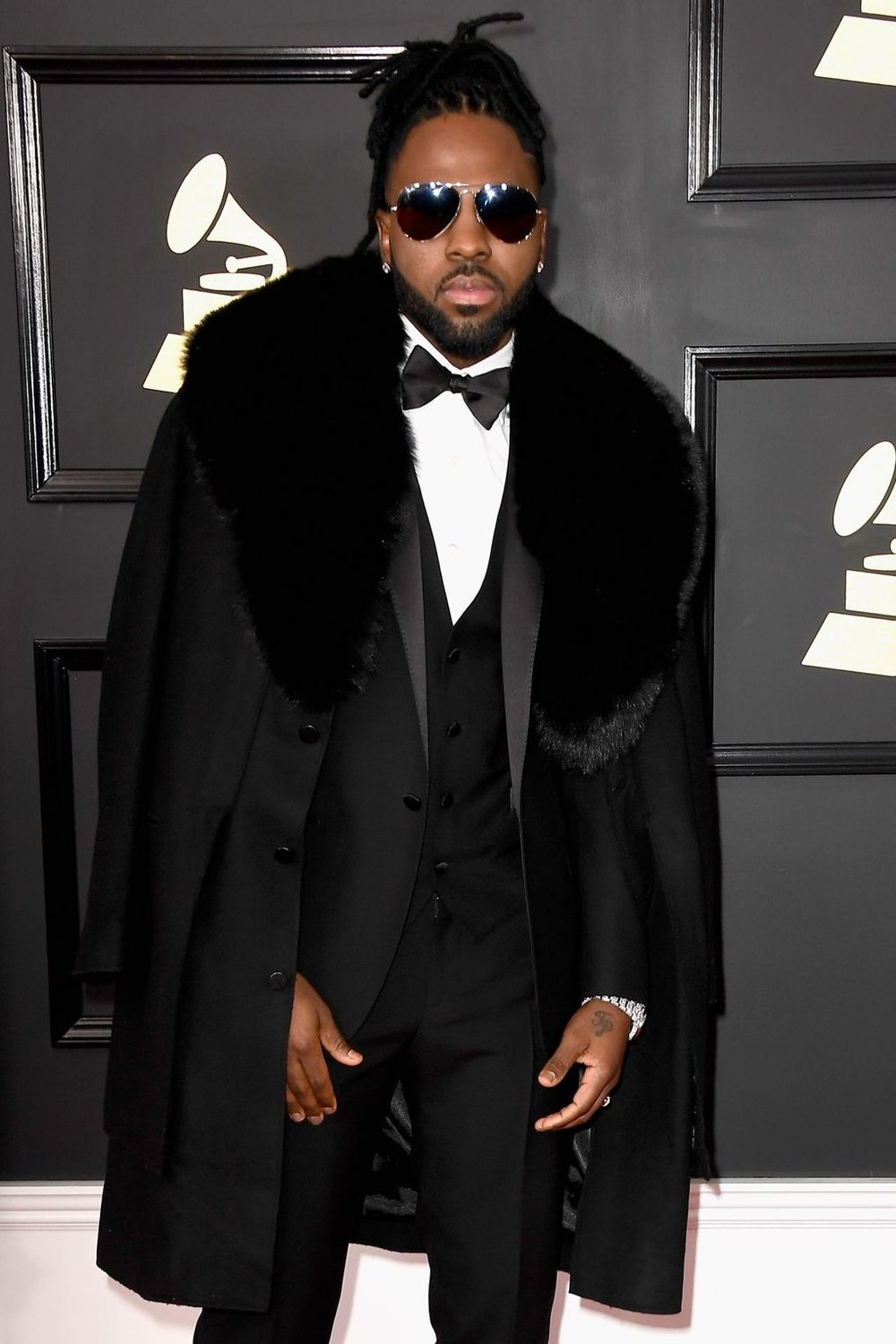 Jason DeRulo literally woofs it up with a perfectly-manicured beard and a luscious fur-collar overcoat layered over a classic suit get-up. This is how you make your presence known on the red carpet.