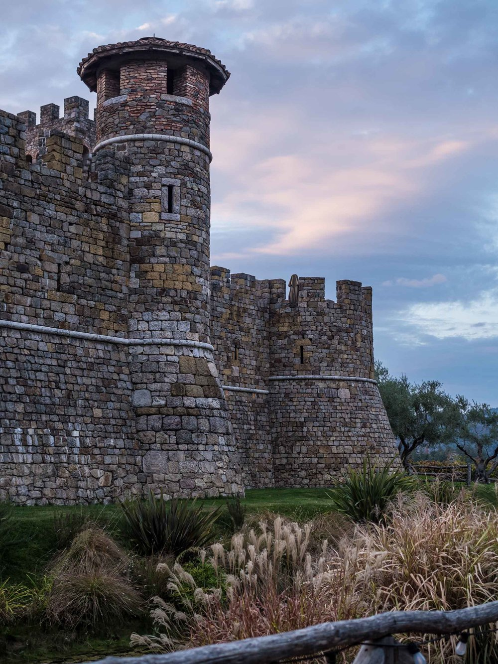 The Castello di Amorosa wine estate at dusk.