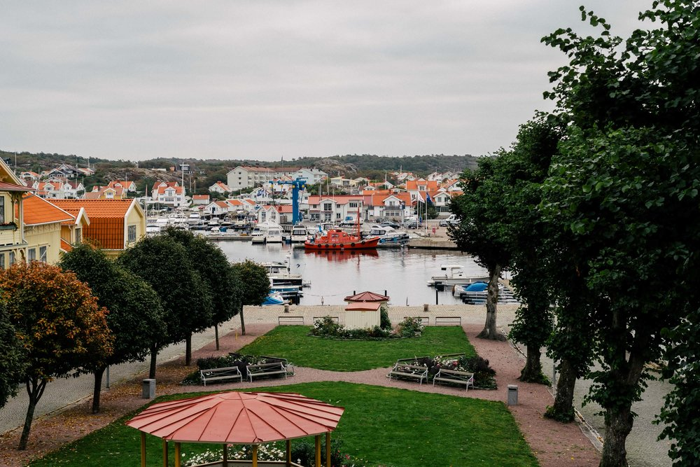 The balcony view overlooking Marstrand's picturesque harbor at the Grand Marstrand Hotel