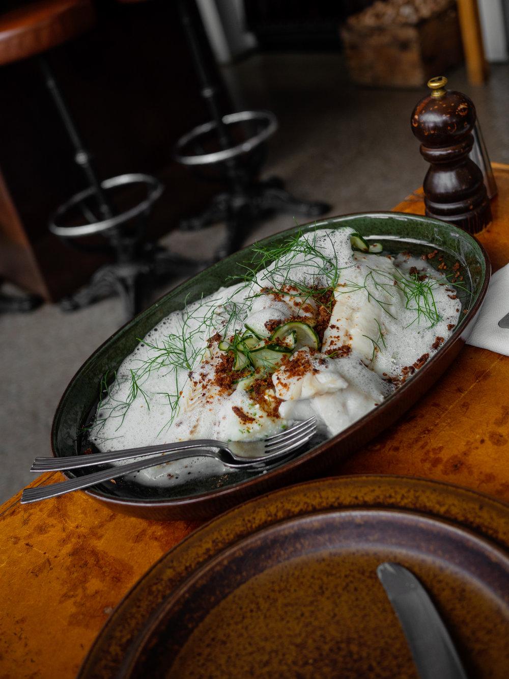 The phenomenal halibut meets potato mash and foam dish at Oaxen Krog. Address: Beckholmsbron 26, 115 21 Stockholm, Sweden Phone: +46 8 551 531 05