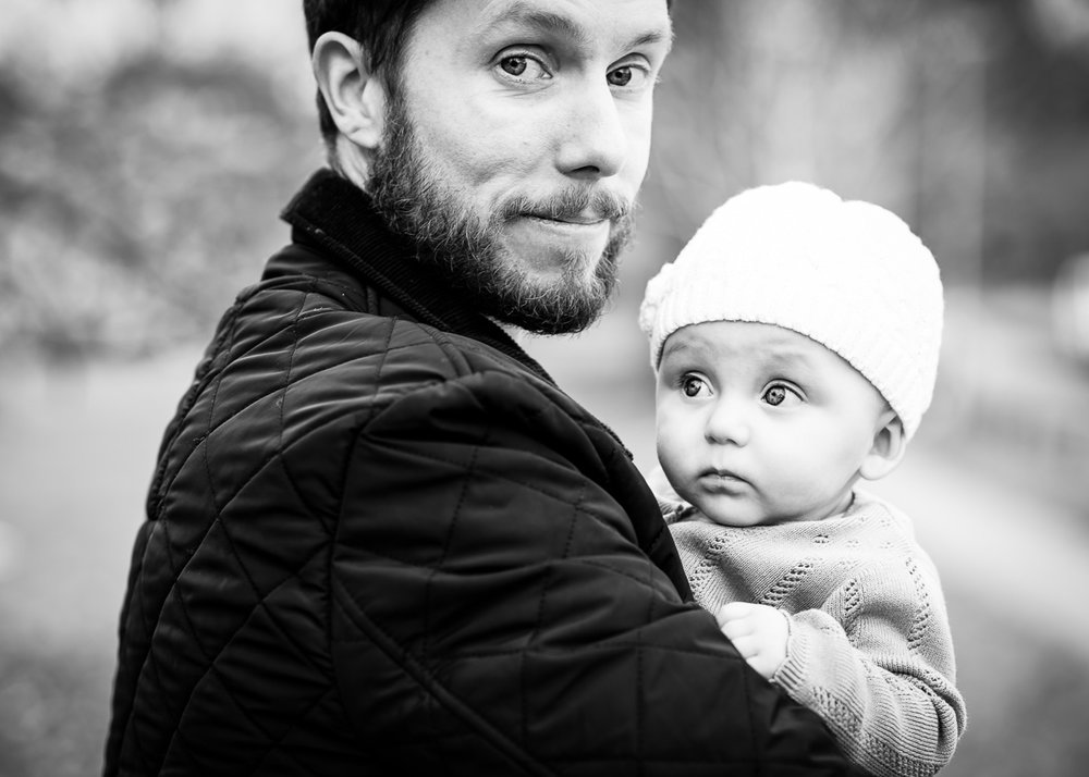Daddy and daughter wrapped up for a cold Autumn family session.