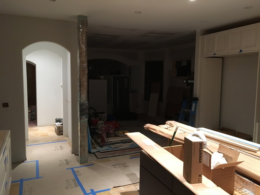 New arch openings with bullnose edges. And check out the structural reclaimed beam that supports the second floor with custom steel reinforcing plate,
