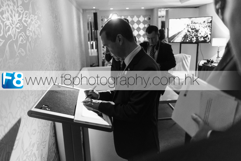 Russian Prime Minister Dmitry Medvedev signs the VVIP guest book back stage after his speech.