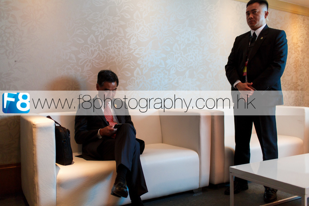 C Y Leung, Chief Executive of Hong Kong relaxing back stage whilst his personal body guard stands close by. A very rare opportunity to get this close to VVIP's in the green room at APEC 2015.