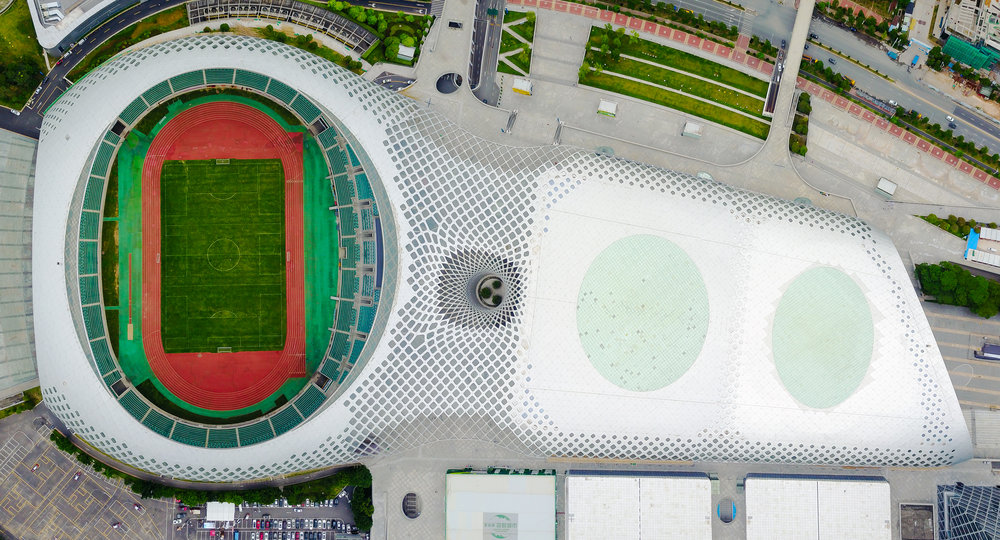Four images used to stich together a panorama of Shenzhen Bay Sports Centre.