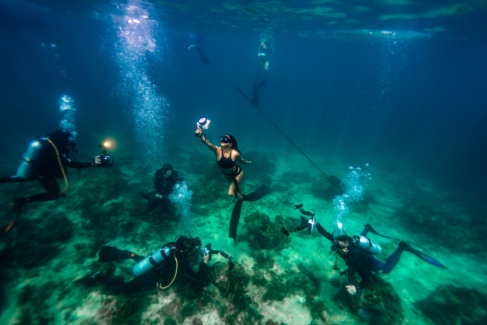 Behind the Scenes with our team shooting a free diver in Puerto Galera, Philippines.