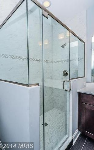 bath, marble surround and subway tile on floor.JPG