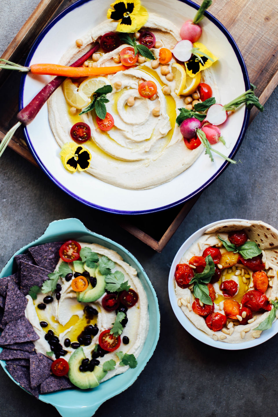 hummus, elevated - these three humus platters get the royal treatment, and make us wish we could jump into the screen to snack on them right now.