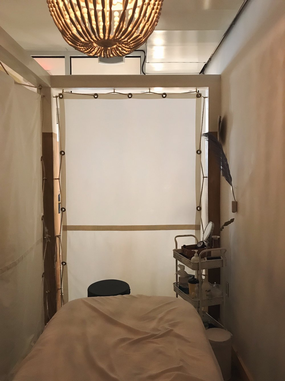 The Massage Space - This was the private room for massages. The minimalist detailing was wonderful. It certainly felt remote and like my own little home. The light fixture cast this dreamy glow that made me want to curl up and nap. Also, can I get that cart in my life?