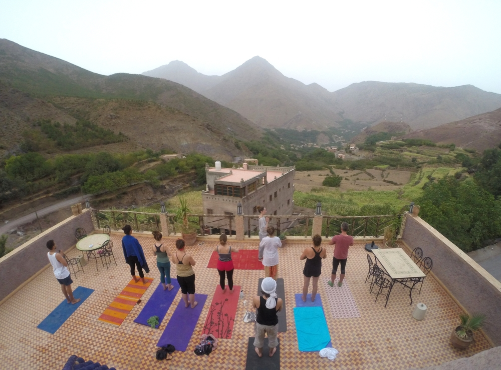 Group class on the roof of a Riad in the Imlil Village , High Atlas Mountain, Morocco.