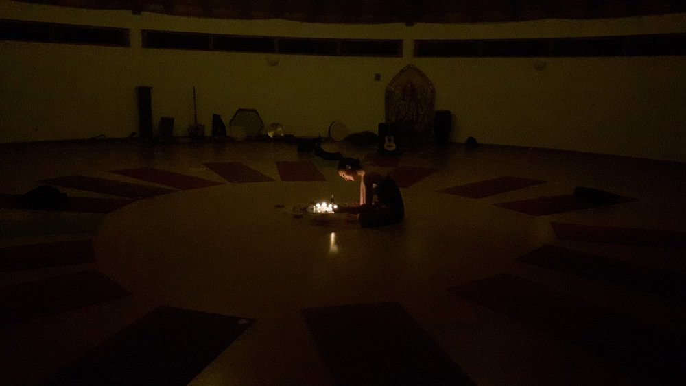 Me lighting candles in the Yoga Space ready for  my evening meditation session.