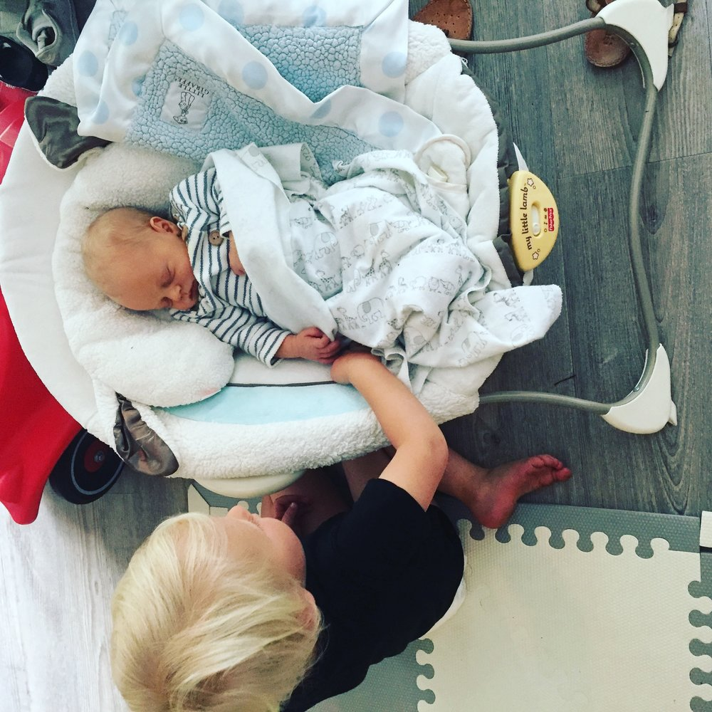 """The first time Felix went up to Hendrix on his own, sat down and looked at him for a while before touching his head and hands. Before that, he had been pointing a lot, saying """"baby. baby. baby!"""" This melted my heart <3"""