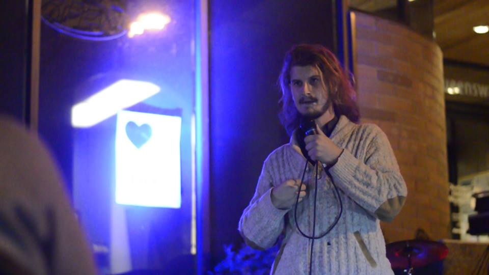 Nygel Metcalfe at the September 2015 Poetry Slam. Photo credit Adam Flockeman.