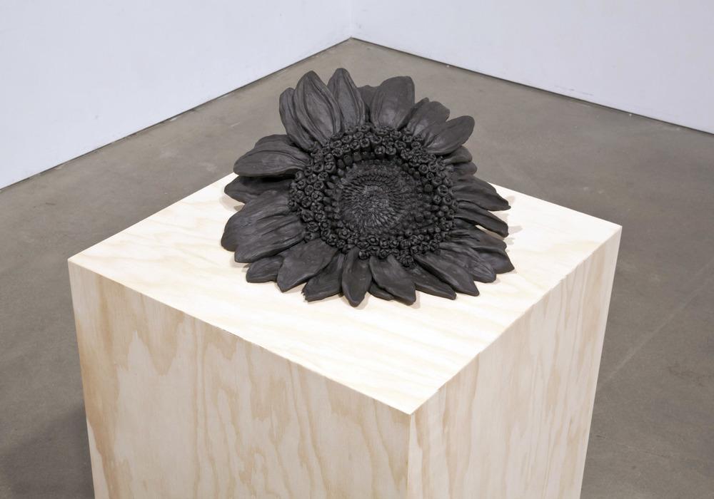 DETAIL  Sunflower , 2013 Stoneware, plywood pedestal 48 x 15 x 15 inches