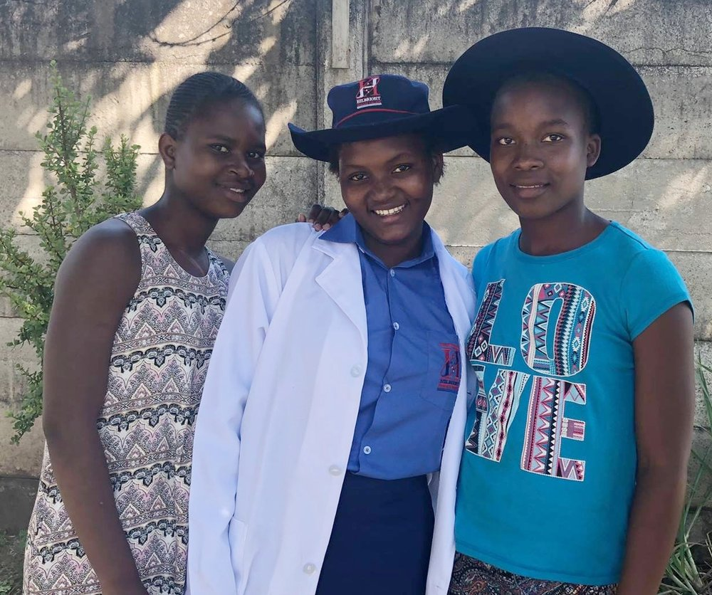 D (center) is starting boarding school this year, and was so excited about her new uniform!