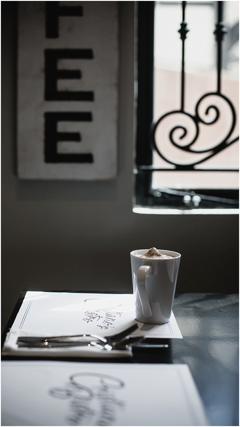 Grabbing a corner and window seat… - We ordered ourselves the perfect cup of roastel with our cream frothed on top.