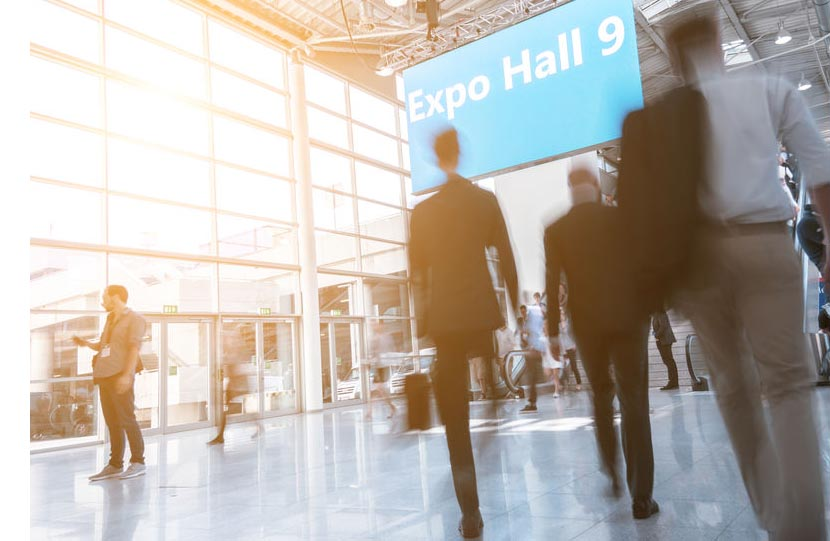 Blurred business people at a expo hall