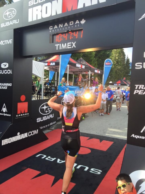 Steph crossing the finish line at Ironman.