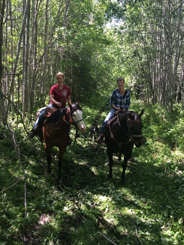 Wendy and her mom riding horses. One of her absolute favourite hobbies.