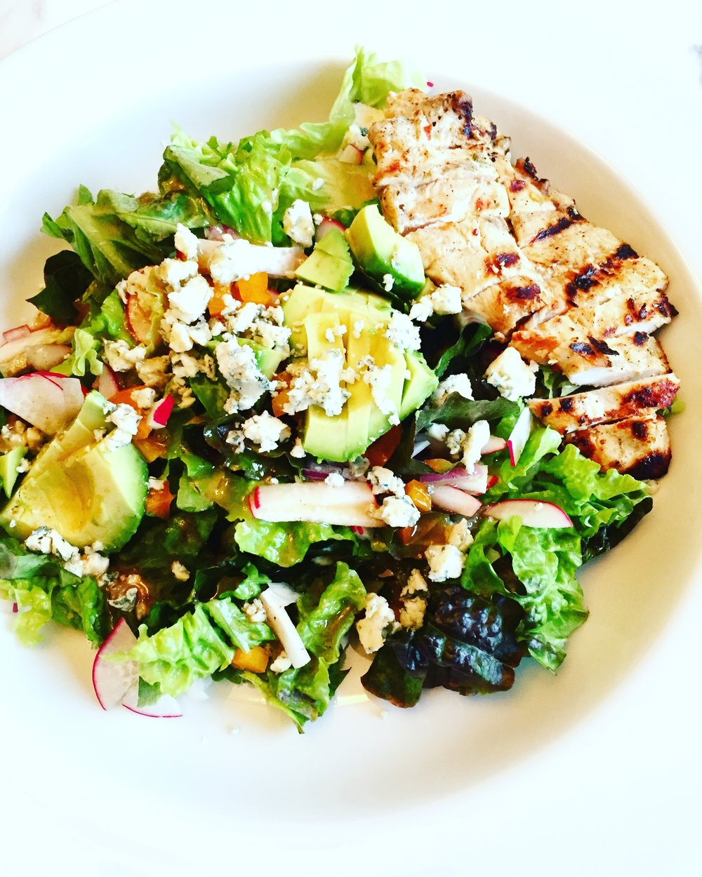 Red leaf lettuce with avocado, grilled chicken, veggies, blue cheese and homemade vinaigrette