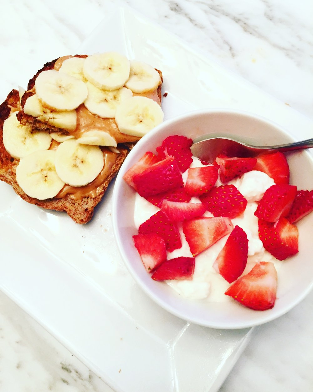 Sprouted bread with Adam's PB and 1/4 banana with cottage cheese and strawberries