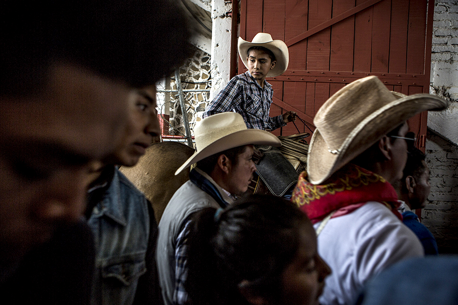 Cheran, Michoacan - Mexico, October 5th, 2015:A young cowboy waits for his turn in the bullfighting plaza during the town's annual festival in homage to San Francisco, the town's patron Saint.Residents of Cheran, which took up arms four years ago and shut down the town, have created a bubble of relative calm amid one of Mexico's most violent states.Photo by Adriana Zehbrauskas for BuzzFeedNews