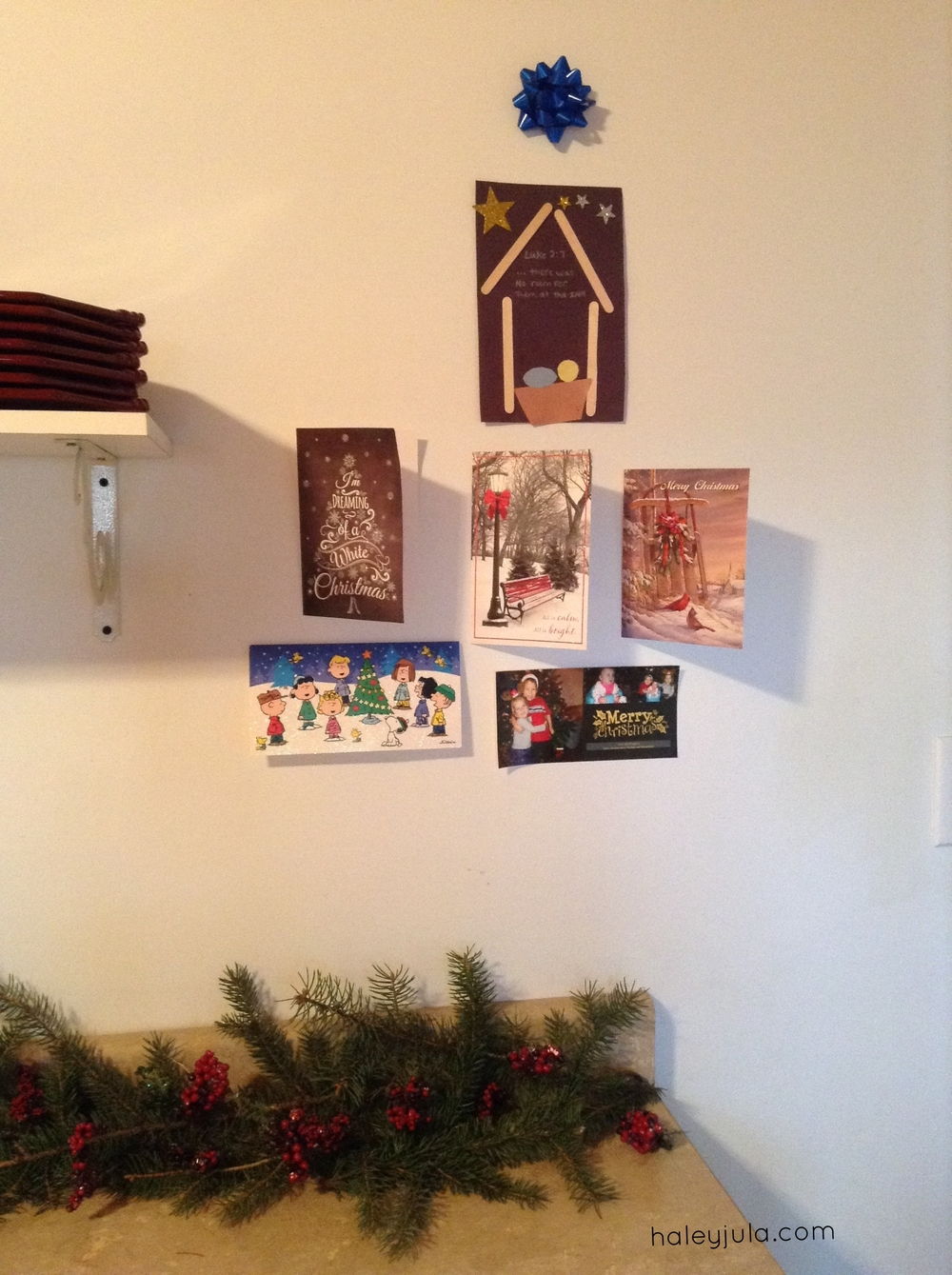 Wall of cards. Added to daily. Going for shape of Christmas Tree.