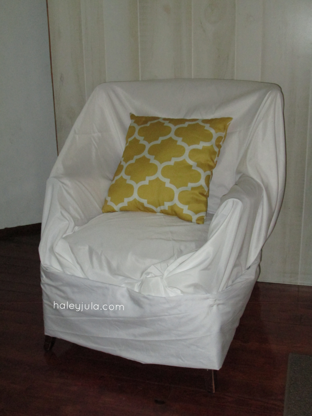Slipcover a chair with flat sheets. That's what I did here!
