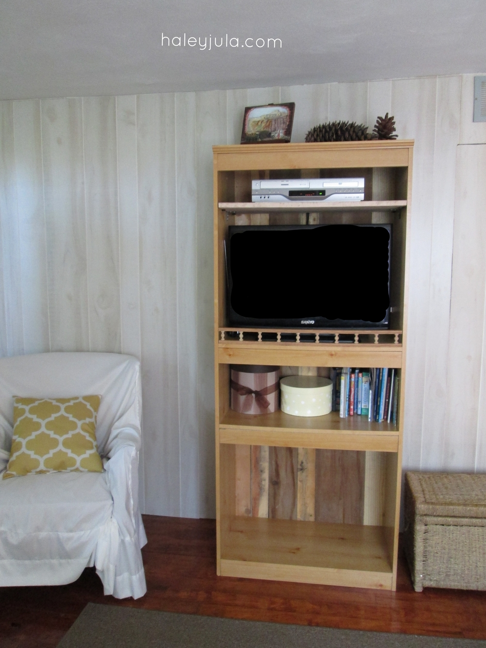 Inside holding the TV