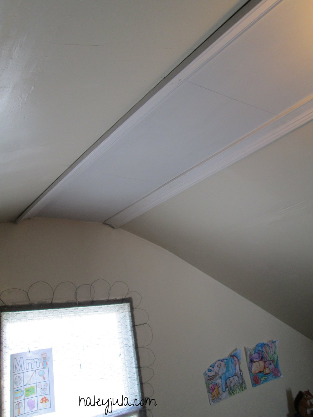 After- The ceiling with trim molding and new paint.