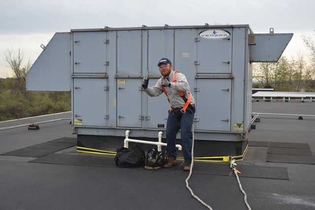 SAFETY is first at ENCON!  One of our crew with his safety gear on tackling an issue on the roof.  #hvac #solar #safety #goodworkpractice #technicians