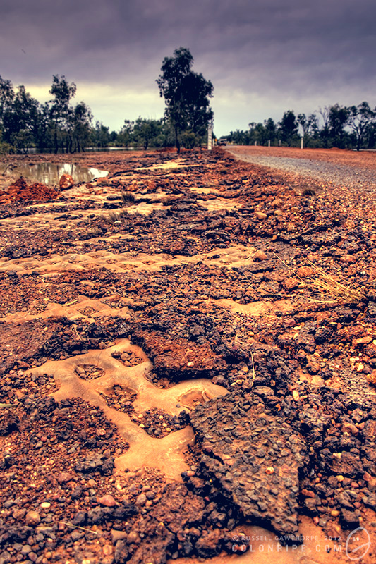 Some of the huge amount of road debris washed from the surface of the Castlereagh Highway in the 2010 floods.
