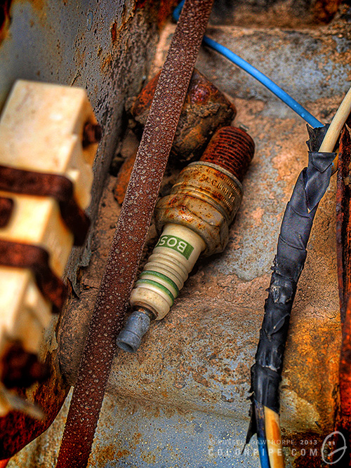 An abandoned spark plug lays beside an old motor. I love the textures this HDR has enhanced.