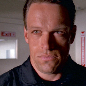 Brian Thompson. Resemblance: 25%.