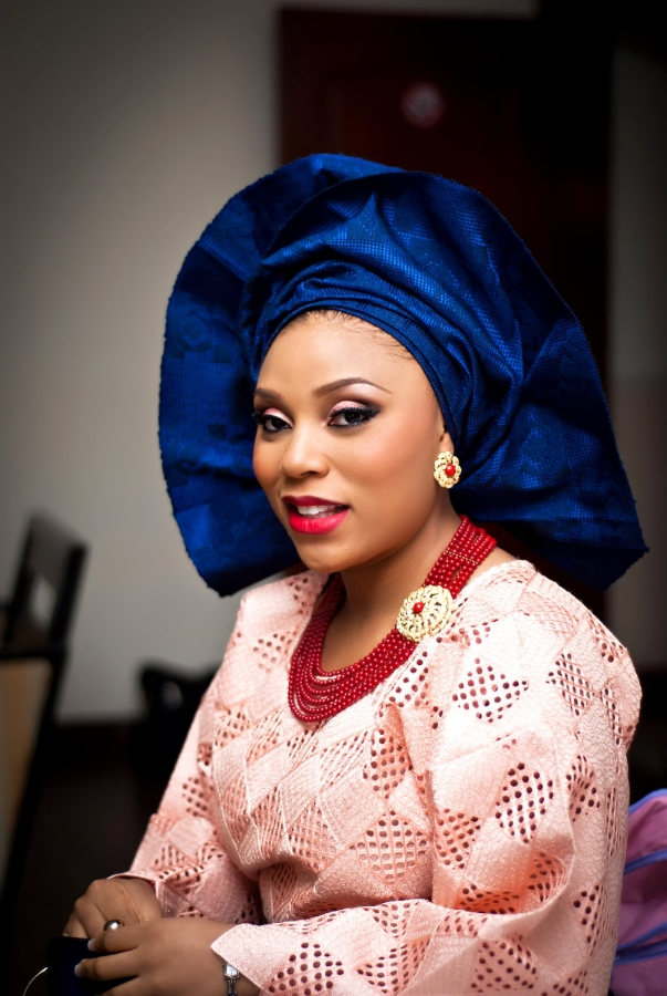 Beautiful Nigerian Bride in Champagne Pink and Blue Gele - By SpicyInc Studio - Wedding Photographers in Lagos