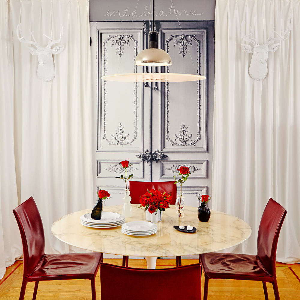 The dining room combines modern classics with playful contemporary accents.