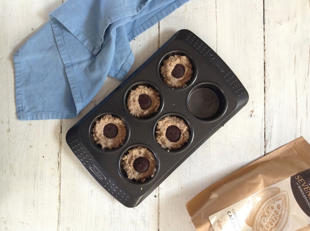 Push Cacao paste wafers gently into center of muffin