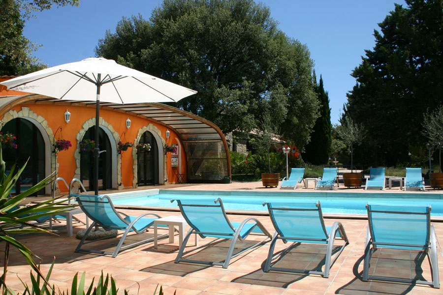 Loungers and umbrella in the sun Bastide Avellanne | EAT.PRAY.MOVE Yoga Retreats | Provence, France