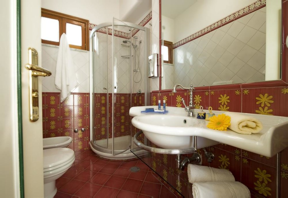 Hand tiled bathrooms Hotel Margherita EAT.PRAY.MOVE Yoga Retreats | Amalfi Coast, Italy
