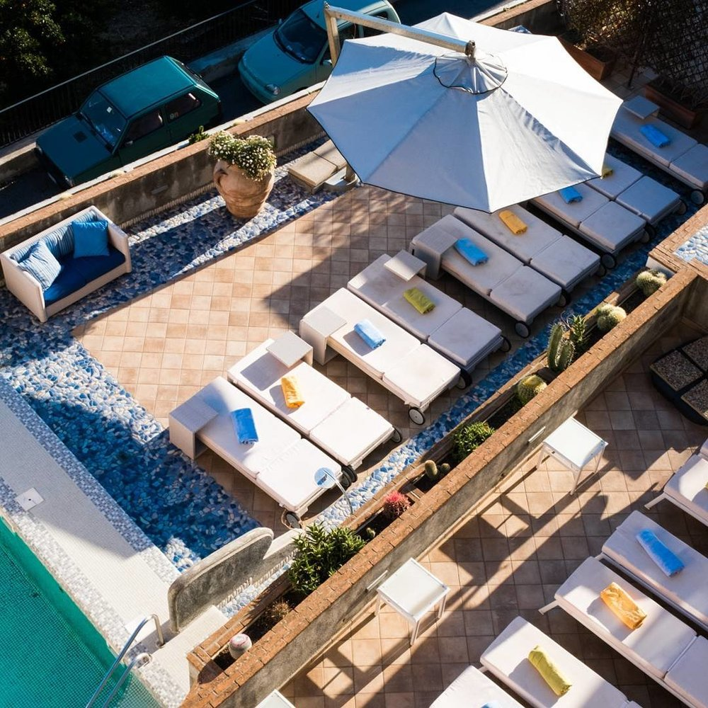 Relaxing deck loungers Hotel Margherita EAT.PRAY.MOVE Yoga Retreats | Amalfi Coast, Italy