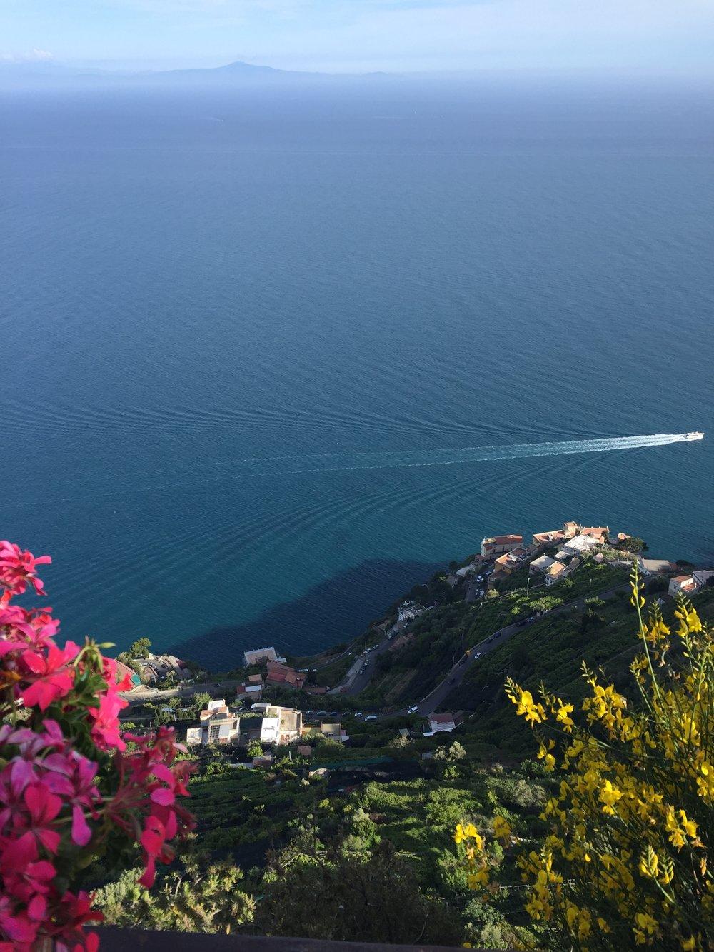 Boats skimming the Positano coast EAT.PRAY.MOVE Yoga Retreats | Amalfi Coast, Italy