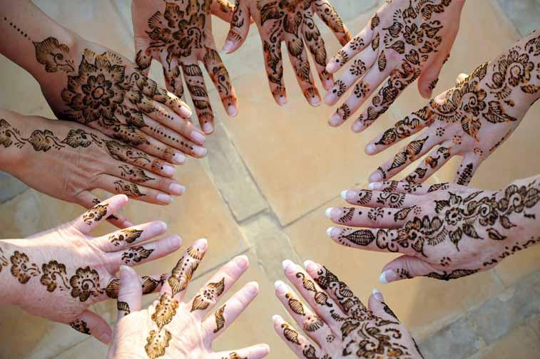 A circle of henna hands Peacock Pavilions EAT.PRAY.MOVE Yoga Retreats | Marrakesh, Morocco
