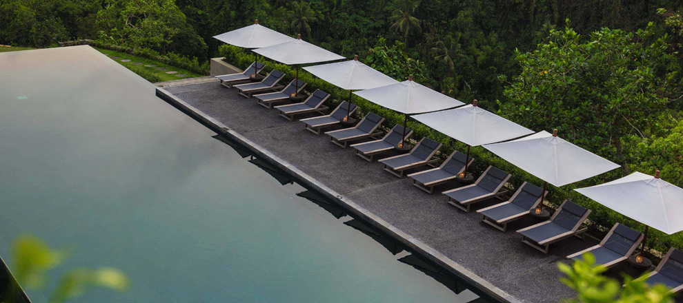 Loungers by the pool Alila Ubud EAT.PRAY.MOVE Yoga Retreats | Bali, Indonesia