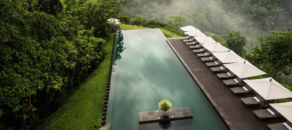Sky high over the infinity pool Alila Ubud EAT.PRAY.MOVE Yoga Retreats | Bali, Indonesia