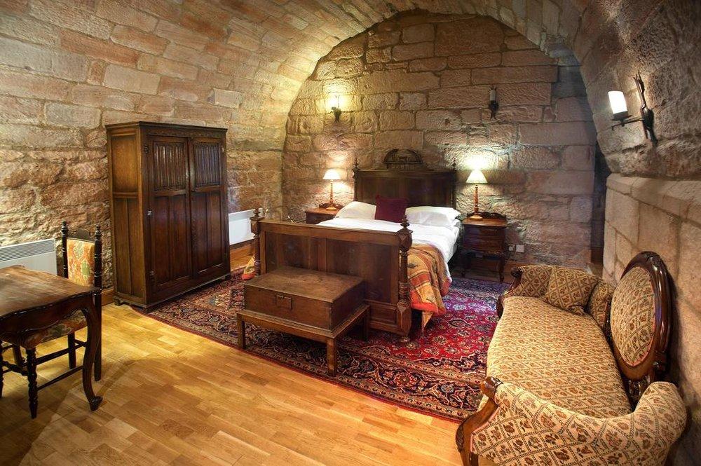 Stone walled bedroom Dalhousie Castle | EAT.PRAY.MOVE Yoga | Edinburgh, Scotland
