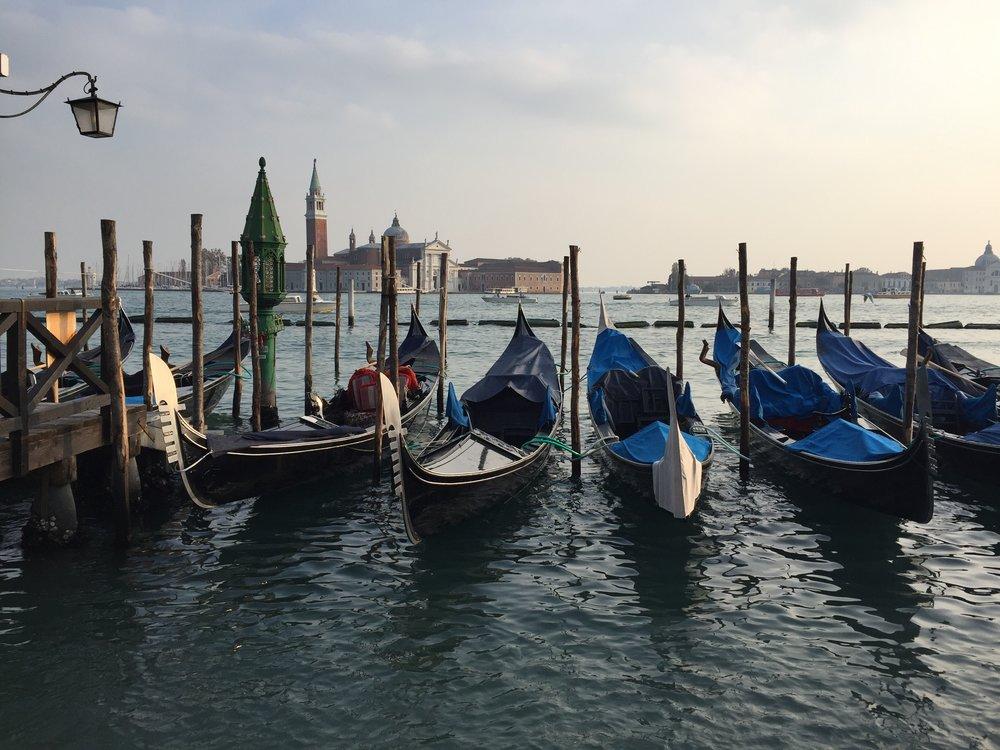 Gondolas float in the ocean EAT.PRAY.MOVE Yoga   Venice, Italy