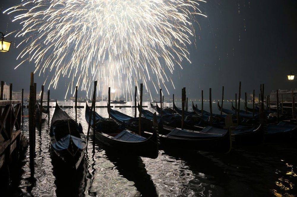 Fireworks over the water EAT.PRAY.MOVE Yoga | Venice, Italy
